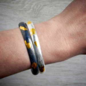 Two Keum Boo Bangles worn together, by Jewellery Maker Fi Mehra