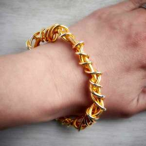 handmade gold vermeil torque bangle with gold vermeil twist detail on wrist