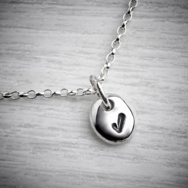 Tiny Tick Pebble by Emma White