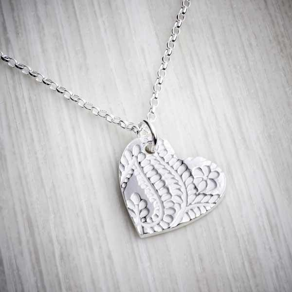 Floral print heart shape silver clay pendant by Elin Mair, Janglerins