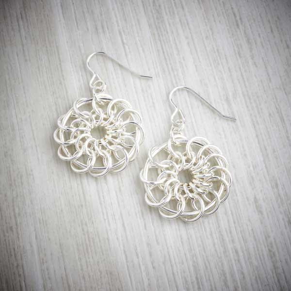 Silver chainmaille chain mail catherine wheel earrings by Laura Brookes