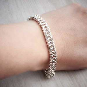 Silver Chainmaille Half Persian Bracelet by Laura Brookes, worn on. Image property of THE JEWELLERY MAKERS