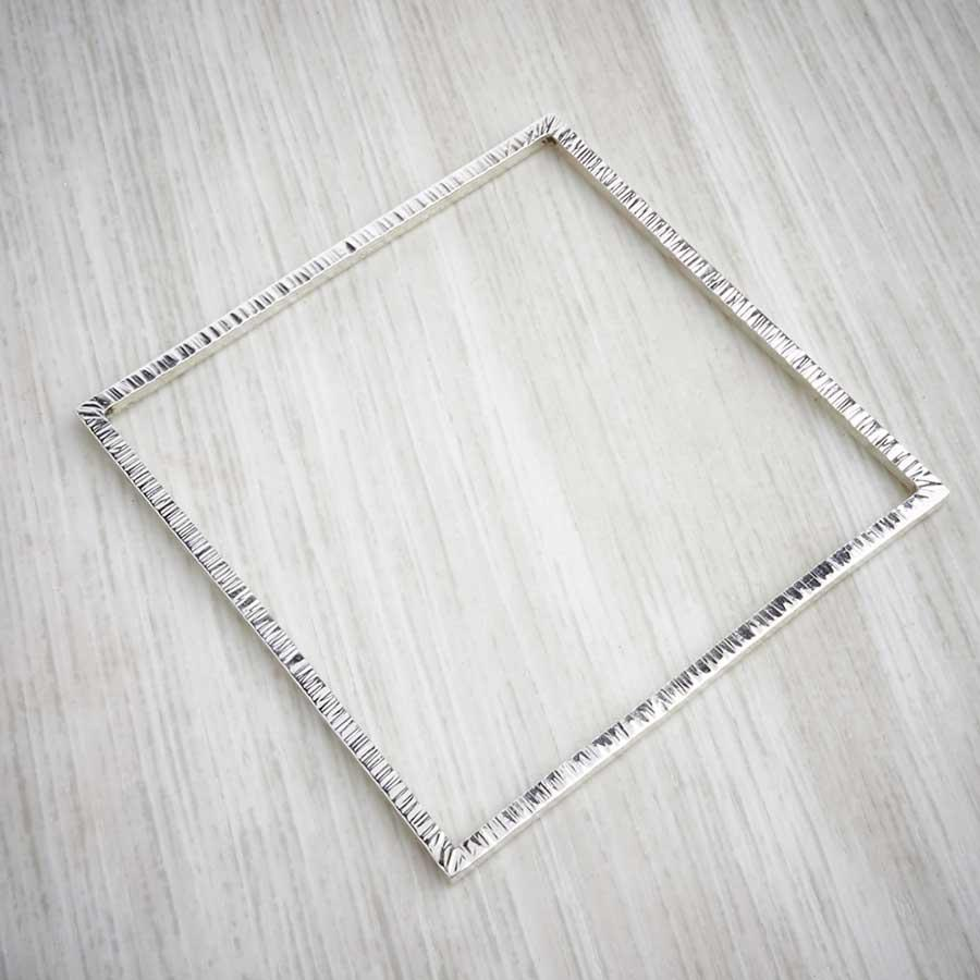 Handmade square silver bangle by Emma White