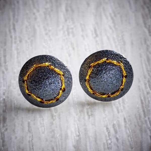 Oxidised (Blackened) Silver, Round Stud Earrings, with Gold Thread Circle by Sara Bukumunhe. Image property image of THE JEWELLERY MAKERS.