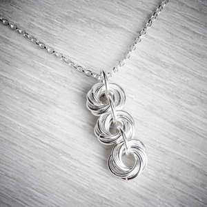 Silver Triple Celtic Knot Necklace by Laura Brookes