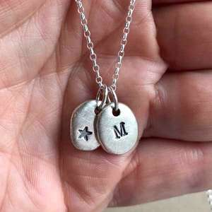 Silver Personalised Initial Necklace with a star drop in hand by Emma White