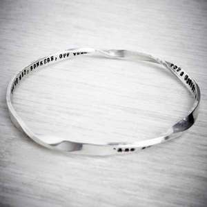 Personalised twisted tales silver bangle by emma White, image property of THE JEWELLERY MAKERS