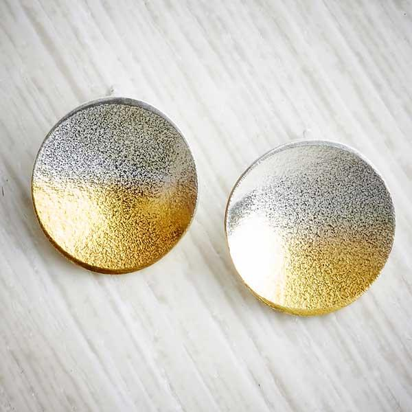 Electra silver and gold ombre large stud earrings by Melanie Ankers, Kokkino. Image property of THE JEWELLERY MAKERS