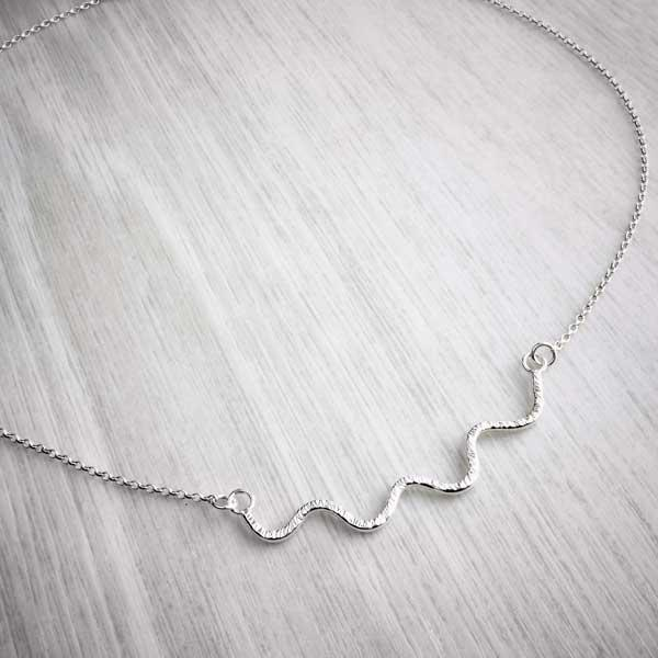 Hammered silver wiggle handmade necklace, wide angle shot, by Alice Chandler. Image property go THE JEWELLERY MAKERS