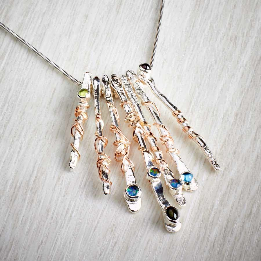 Twffa 7 piece necklace, silver with gold and gemstones by Sally Ratcliffe. Image property of THE JEWELLERY MAKERS