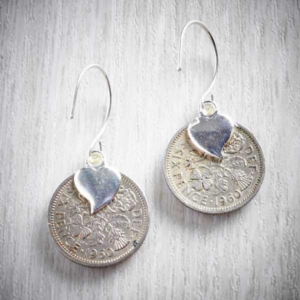The backs of silver sixpences, made into earrings with resin and paper fronts