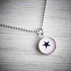 Small Silver & Resin Star Charm Pendant by Clare Collinson. Image property of THE JEWELLERY MAKERS.