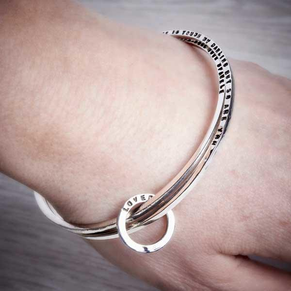Double personalised bangle, for a long message, worn on by Emma White