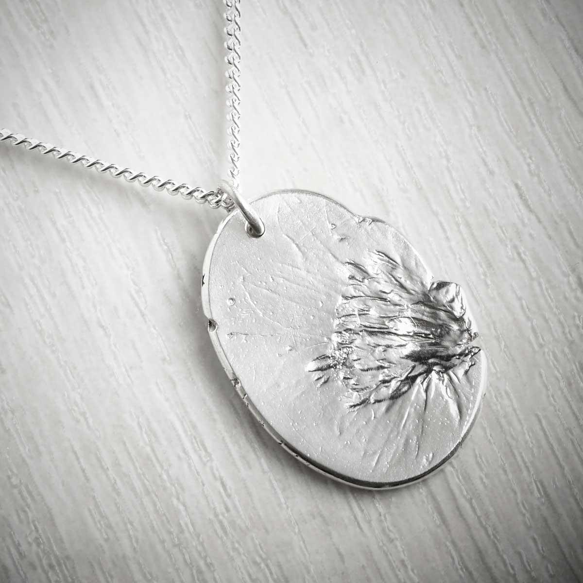Cosmos October Fossil Pendant by Becca Macdonald. Image property of THE JEWELLERY MAKERS.