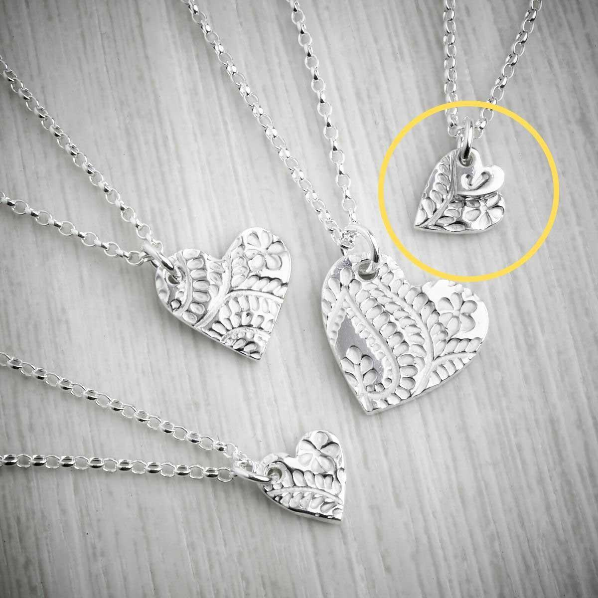 Silver Clay Floral Heart Necklaces by Elin Mair. Image property of THE JEWELLERY MAKERS.