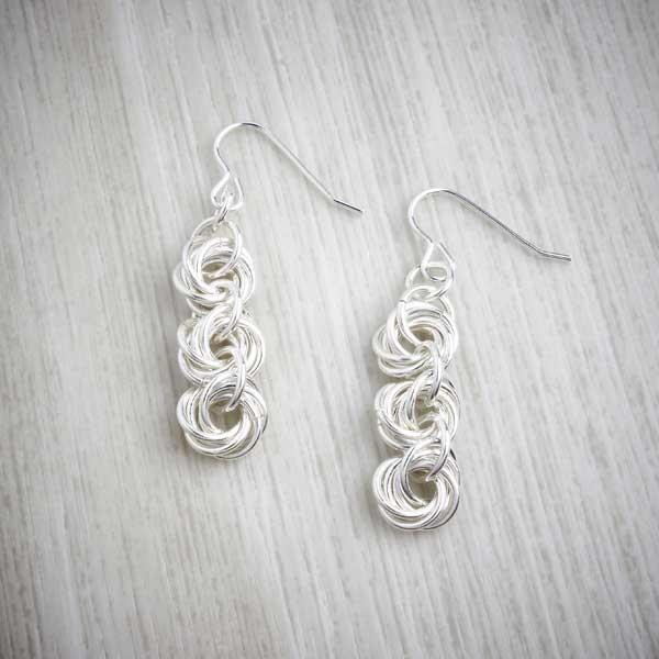 Silver Triple Knot Earrings by Laura Brookes