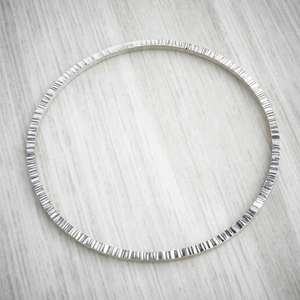 Hammered edge silver geometric round handmade bangle