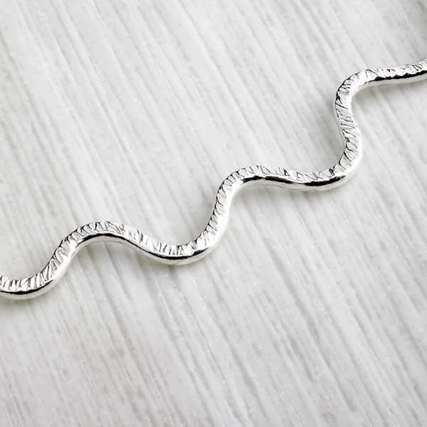 Hammered silver wiggle handmade necklace, crop shot, by Alice Chandler