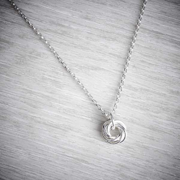Silver Small Single Celtic Knot Necklace by Laura Brookes, wider shot