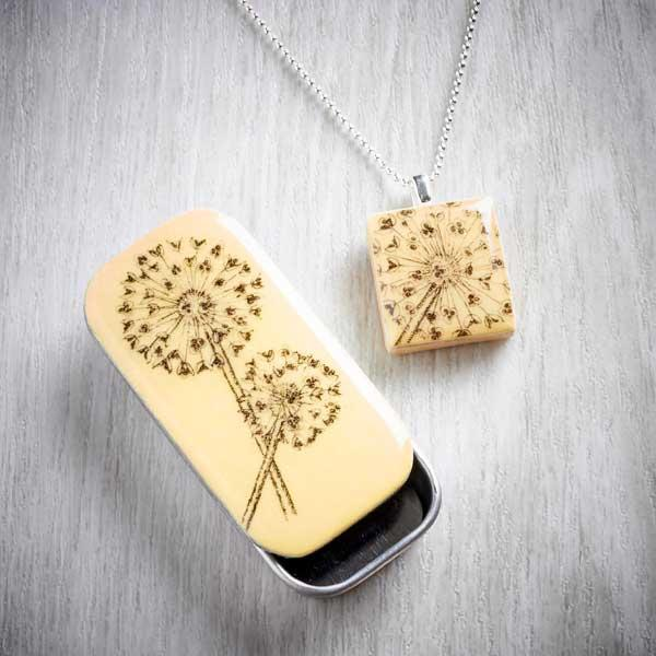 Allium Scrabble Tile Pendant and Tiny Tin by Leigh Shepherd. Image property of THE JEWELLERY MAKERS.