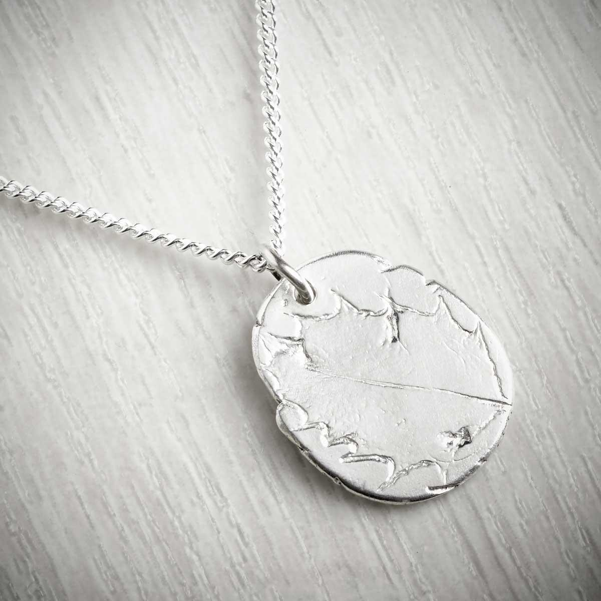 Holly December Fossil Pendant by Becca Macdonald. Image of THE JEWELLERY MAKERS.