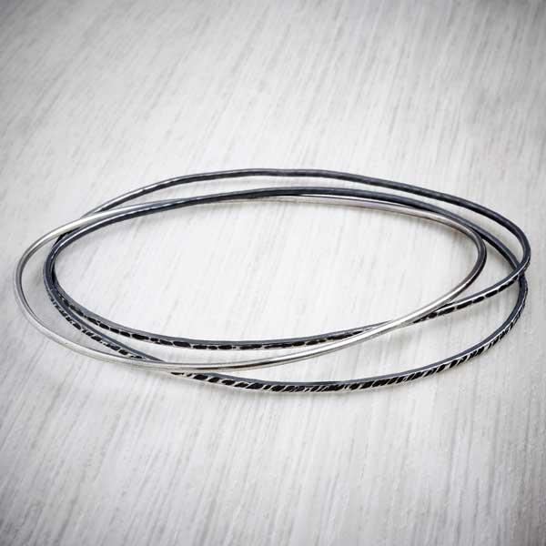 Oxidised silver bangles by Evie Milo, Milomade. Image property of THE JEWELLERY MAKERS