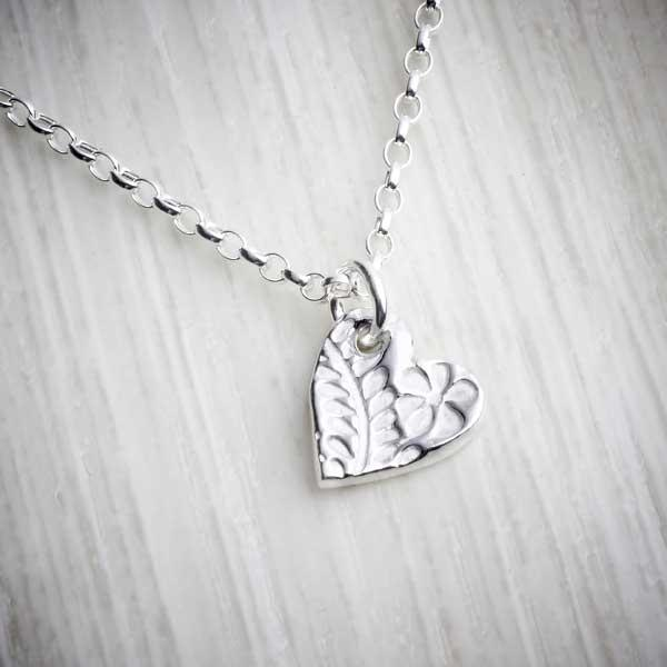 Small heart charm silver clay bracelet by Elin Mair