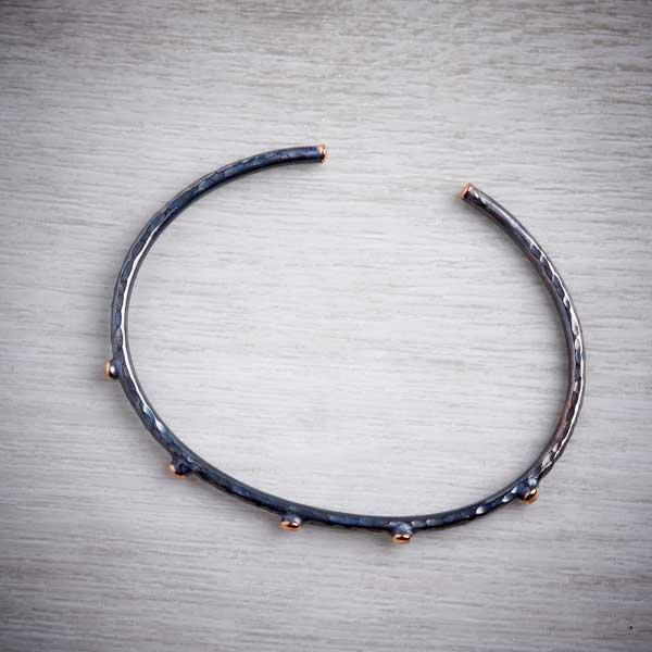 Handmade black silver bangle with rose gold nuggets