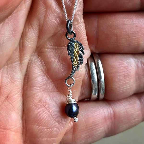 Angel Wing Oxidised Pendant by Fi Mehra, silver and gold keum boo with a fresh water dark pearl in the hand