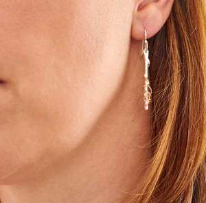 Ivy Twist post earrings, silver with gold details by Sally Ratcliffe, Image property of THE JEWELLERY MAKERS, worn on