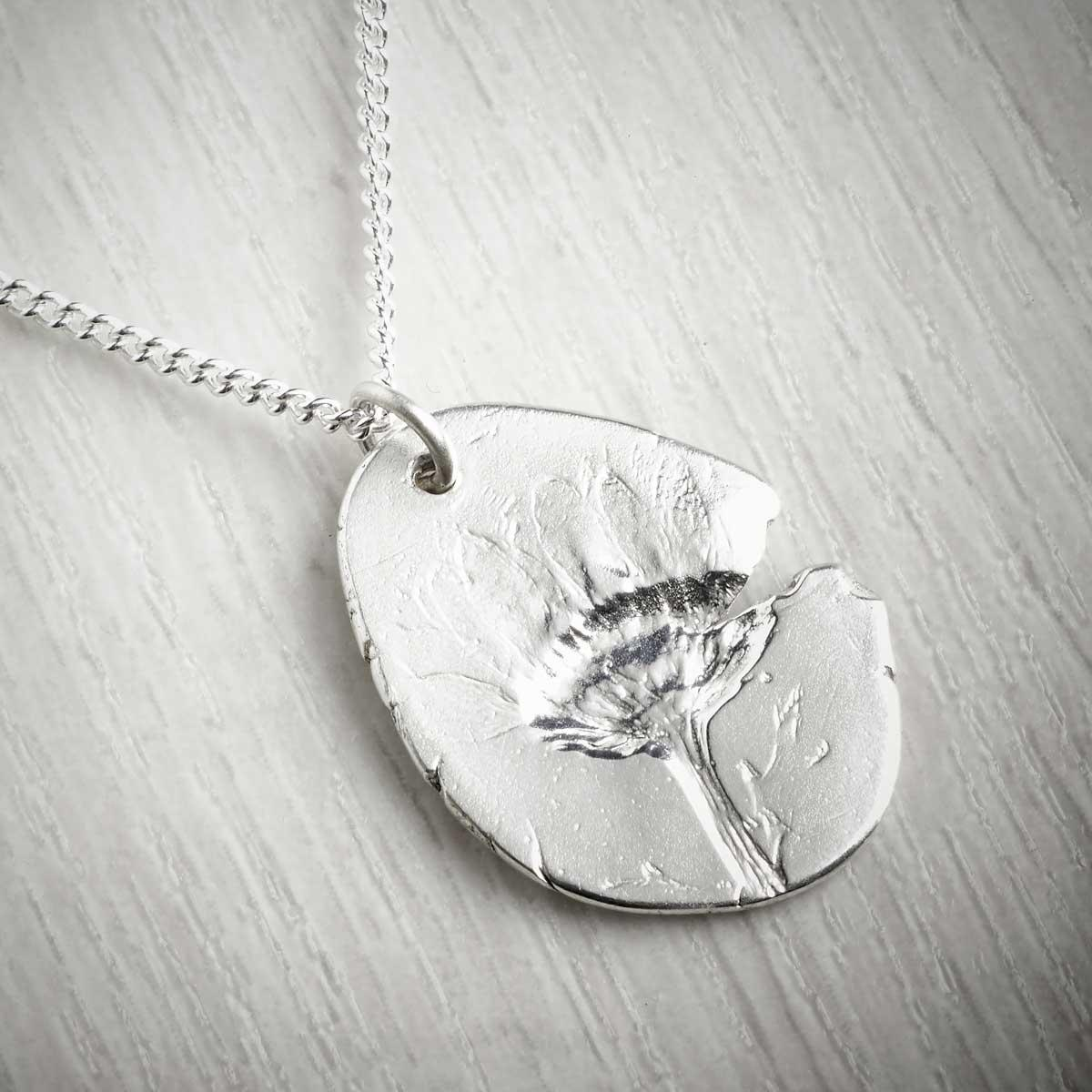 Chrysanthemum November Fossil Pendant by Becca Macdonald. Image property of THE JEWELLERY MAKERS.
