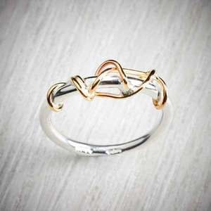 Ivy twist ring, silver & gold details by Sally Ratcliffe, image property of THE JEWELLERY MAKERS