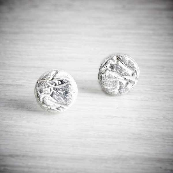 Silver Creased Studs by Becca Macdonald on grey background