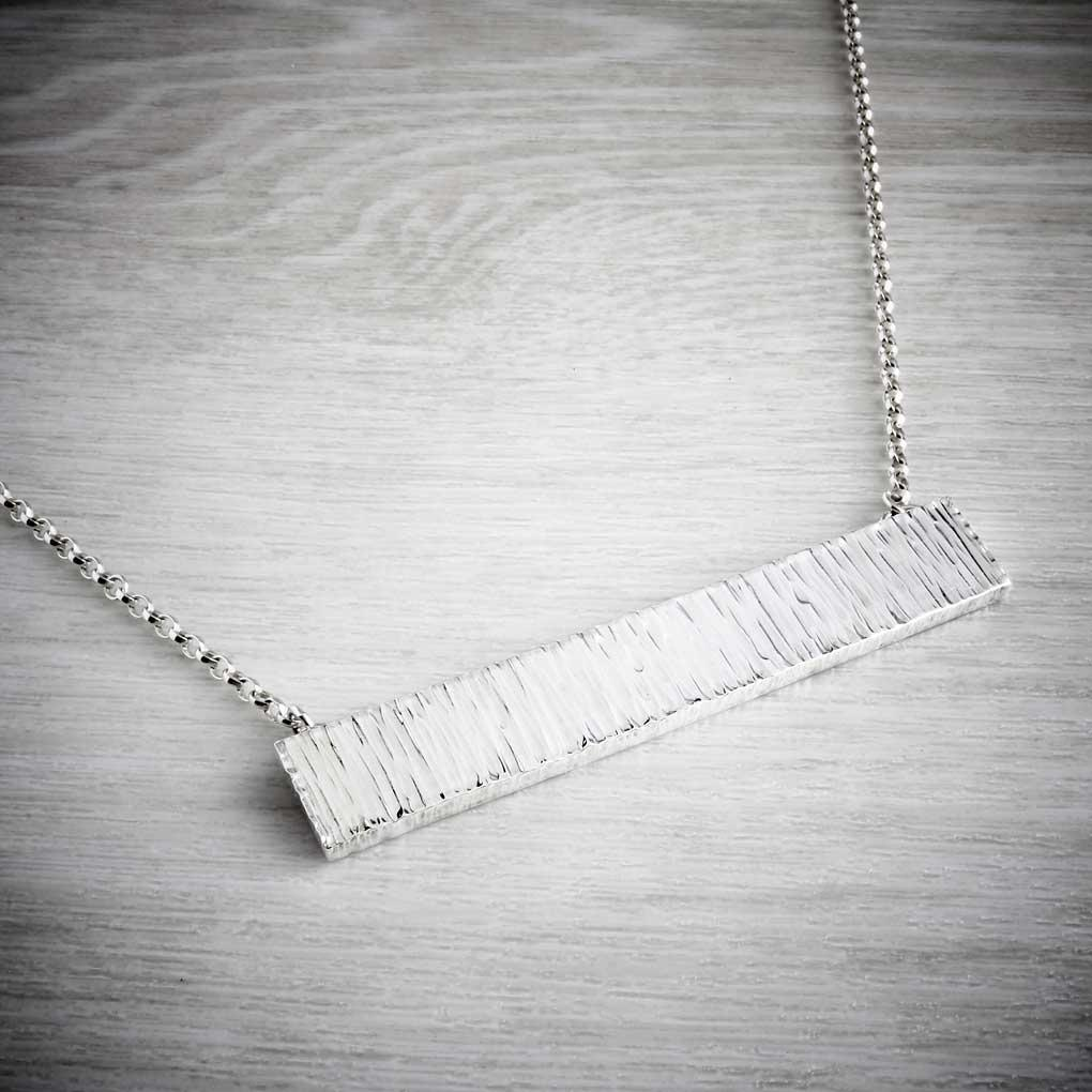 Big chunky hammered bar necklace by Emma White. Image property of tHE JEWELLERY MAKERS