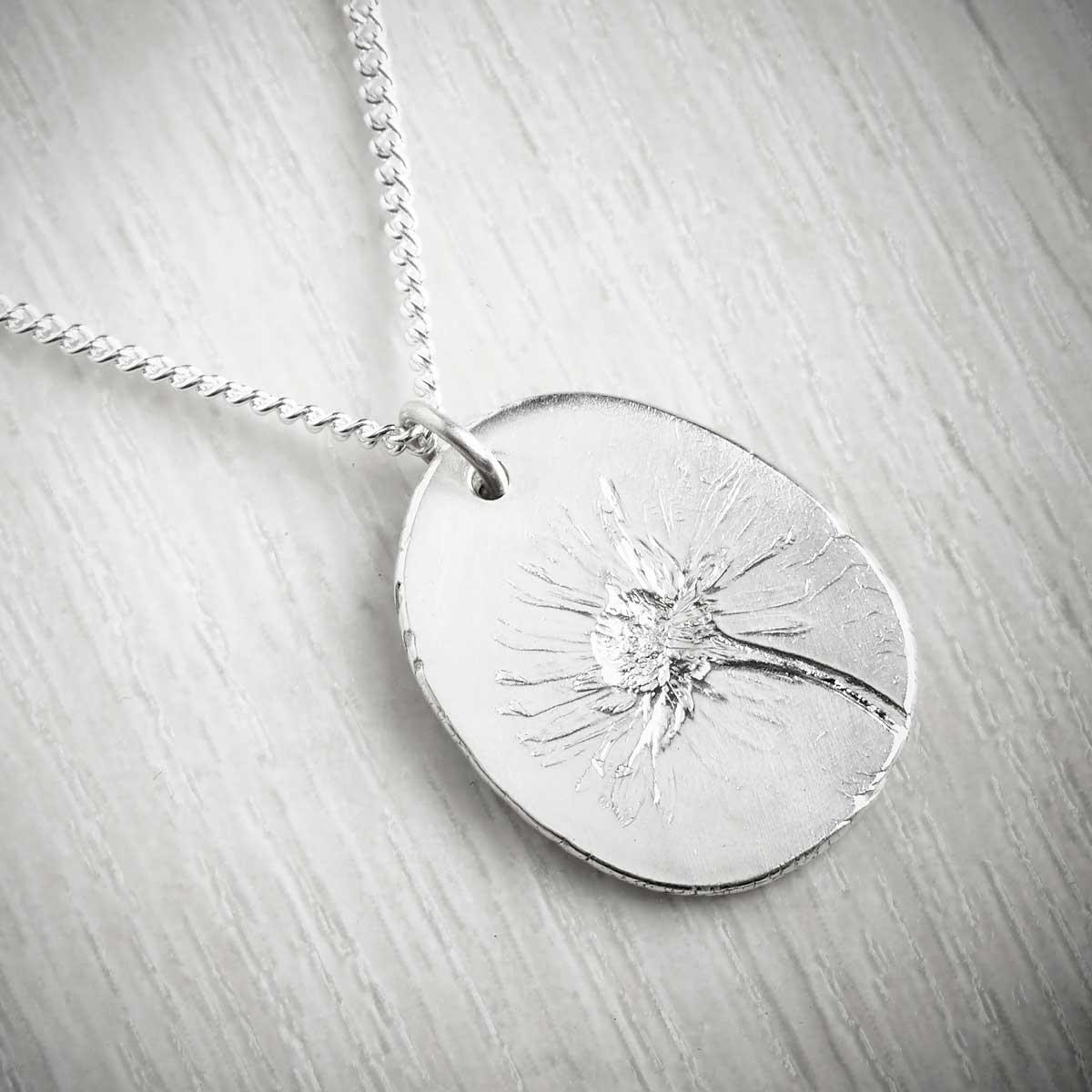 Daisy April Fossil Pendant by Becca Macdonald. Image property of THE JEWELLERY MAKERS.