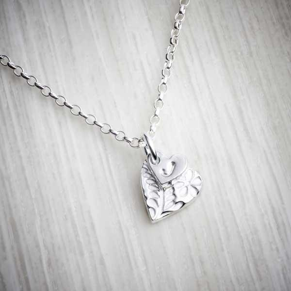 Silver Clay Personalised Small Floral Heart Necklace by Elin Mair. Image property of THE JEWELLERY MAKERS.