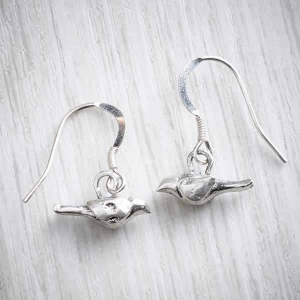 Handmade silver bird earrings by Xuella Arnold, image property of THE JEWELLERY MAKERS.