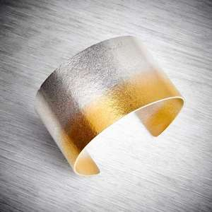 Electra Silver and Gold Wide Cuff by Melanie Hamlet. Image property of THE JEWELLERY MAKERS