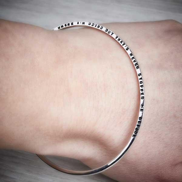 Silver Tiny Text Personalised Bangle, long message by Emma White, worn on a hand