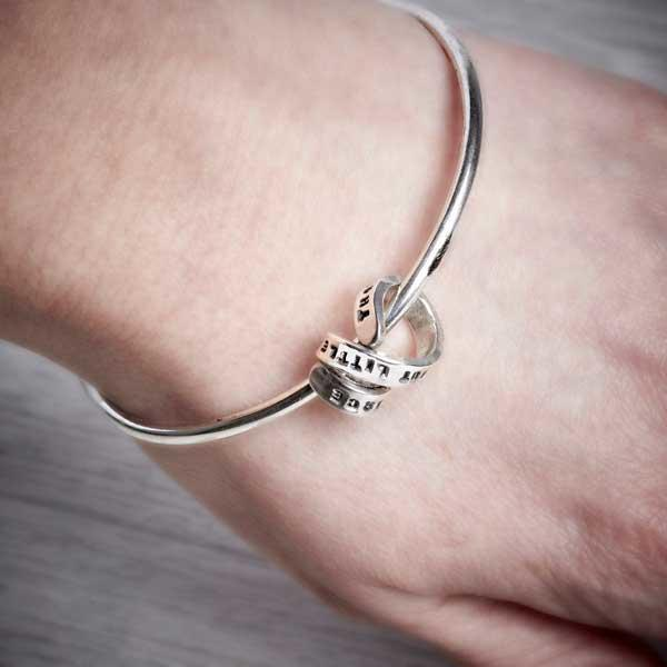 Silver Bangle with Personalised Story Spiral by Emma White, worn on.