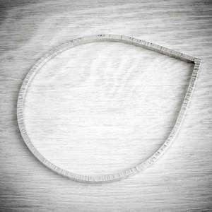 Teardrop silver bangle by Emma White, image owned by THE JEWELLERY MAKERS