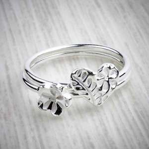 Silver clay stacking rings by Elin Mair, heart and flower combo