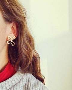 Abstract handmade Brass stud earrings by Alice Chandler, model shot