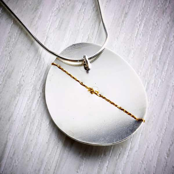 Silver and gold large oval necklace back view by Sara Buk