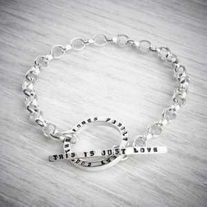 handmade personalised silver toggle bracelet on grey background