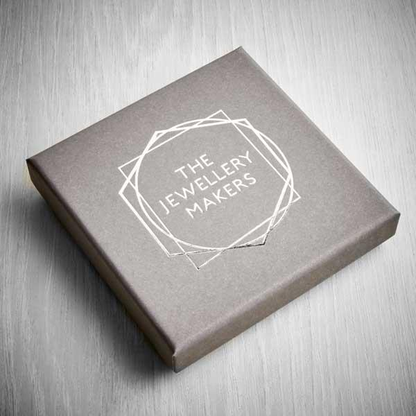 Tje jewellery makers grey box with silver logo
