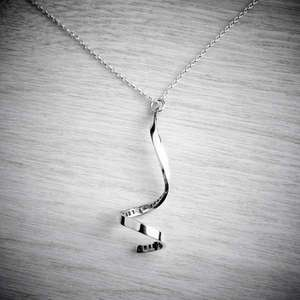 Personalised silver spiral necklace by Emma White