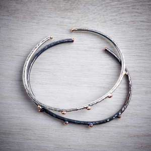 Contemporary handmade silver bangle with rose gold nuggets and oxidised silver bangle with gold nuggets