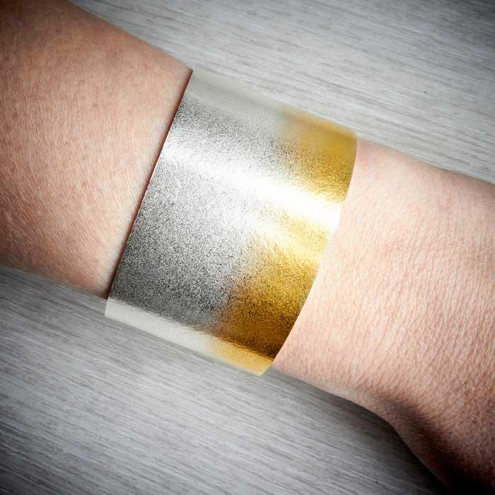 Electra Silver and Gold Wide Cuff by Melanie Hamlet. Image property of THE JEWELLERY MAKERS, worn on