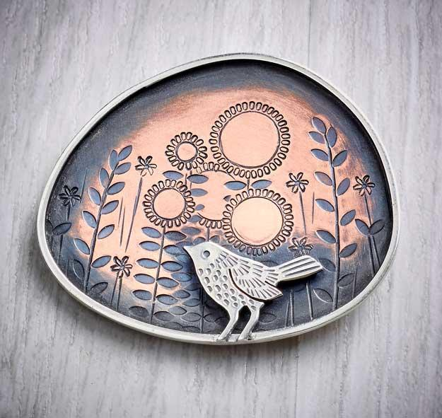 Silver and copper bird brooch by Helen Shere